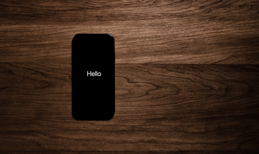 turned on black iphone 7 displaying hello 1275929 1